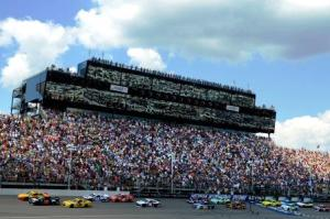 Cars race around the track at Michigan International Speedway in Brooklyn, Mich., last year.