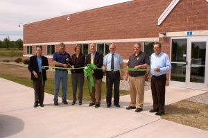 The West Branch ribbon-cutting ceremony included (L to R) Rich Ford, VP/transmission for Consumers Energy; Julian Zielinski, UWUA Local 144 President; Michele Kirkland, VP/energy operations for Consumers Energy; Sen. John Moolenaar (R-Midland); Rick Benjamin, Ogemaw County EDC President; Mark Bridgewater, UWUA State Council Rep; Jay Jacobs, Consumers Energy area manager.