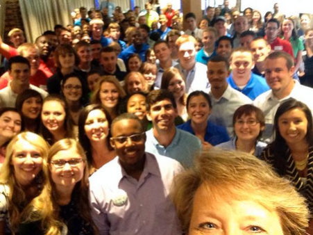 Interns pose for a 'grouphie' at the Intern Luncheon 2014.