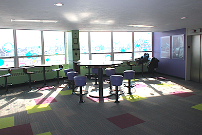 The newly renovated space to study and socialize is designed with colorful circles, geometric patterns and charging stations.