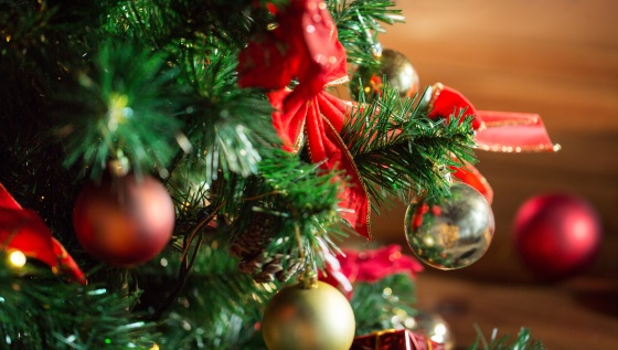 holidays, new year and celebration concept - close up of christmas tree decorated with balls