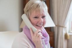 Smiling Senior Woman Making Phone Call At Home